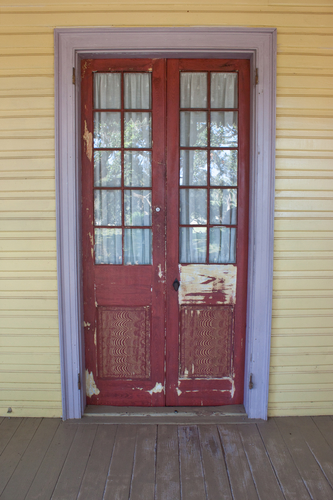 an old worn door on a creole plantation house
